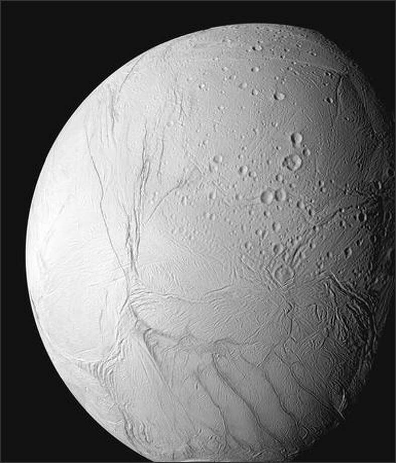 Saturn moon Enceladus shows evidence of liquid water, which means it might support life. Photo: / Associated Press