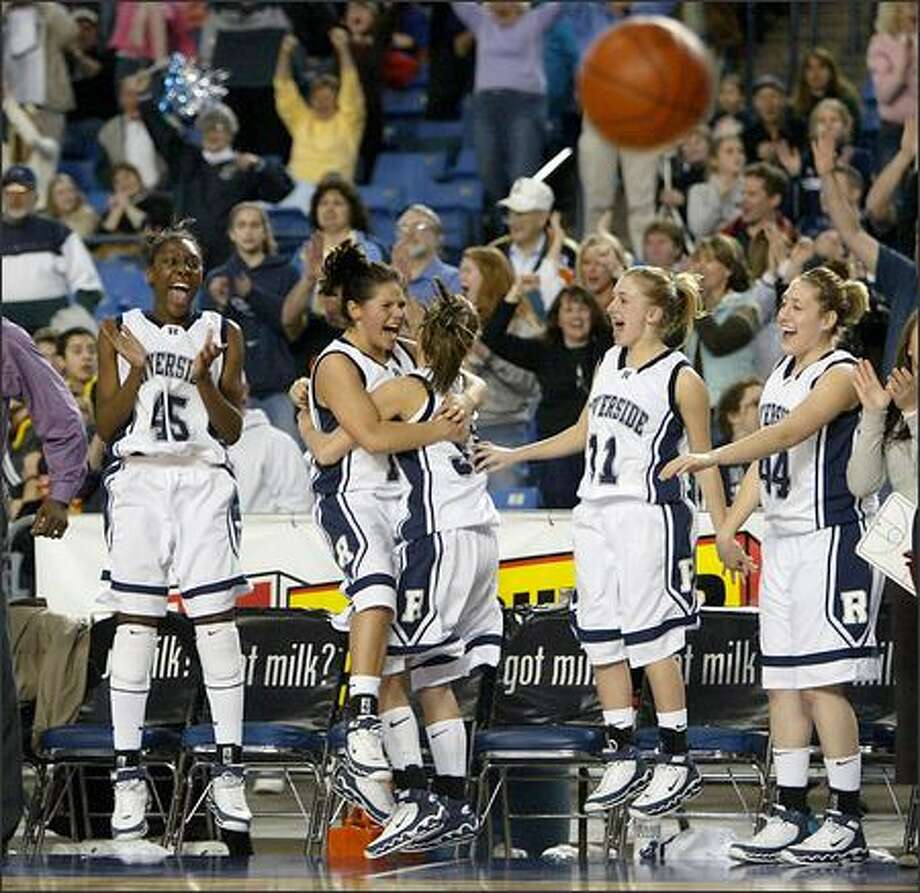 The Auburn Riverside bench erupts in the final seconds of a 50-46 victory over Eisenhower on Thursday. The Ravens are shooting for their first girls basketball state title. Photo: Scott Eklund/Seattle Post-Intelligencer