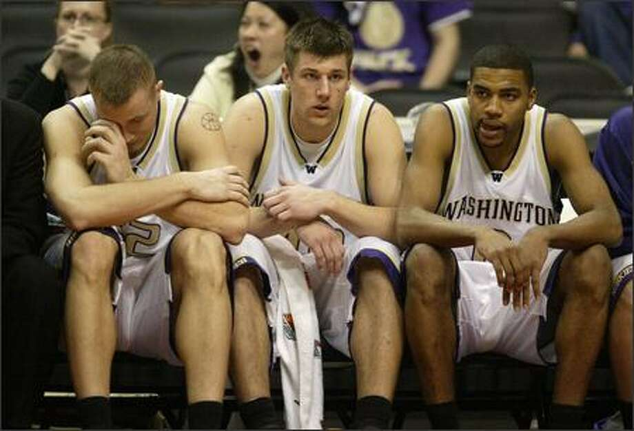 From left, Mike Jensen, Jon Brockman and Joel Smith appear stunned at the end of the loss to Oregon, which is expected to affect the Huskies' NCAA Tournament seed. Photo: Mike Urban/Seattle Post-Intelligencer