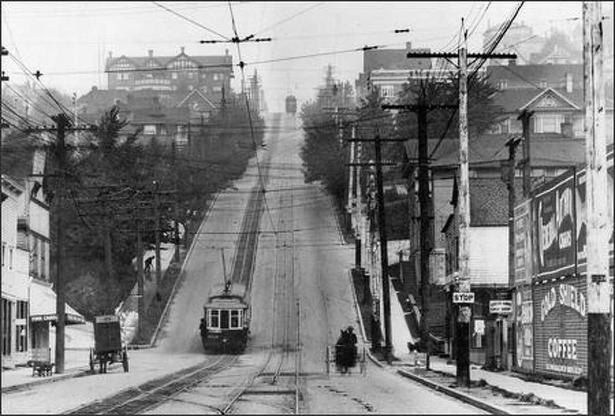 """From 1898 until Aug. 10, 1940, streetcars (here seen in 1910) made their way between upper and lower Queen Anne Hill, assisted by a weighting system called a """"counterbalance."""""""