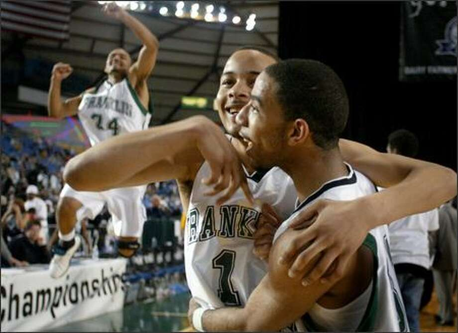 Franklin's Zach Williams, left, Venoy Overton, center, and Donnie Cheatham celebrate the Quakers' 80-76 win against Curtis. They meet Central Valley for the 4A title tonight. Photo: Joshua Trujillo/Seattle Post-Intelligencer