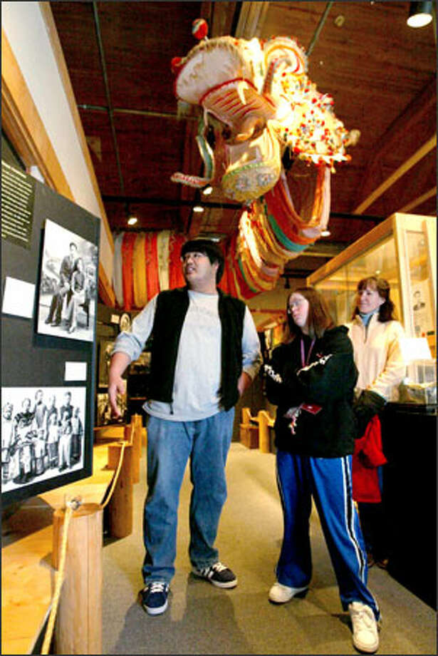 Russel Bareng leads a tour through the Wing Luke Asian Museum, which celebrated its 40th anniversary Sunday. Photo: Paul Joseph Brown/Seattle Post-Intelligencer