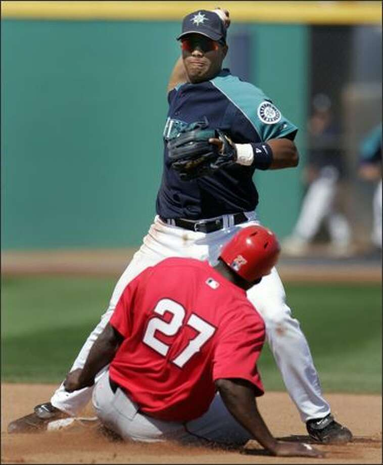 Jose Lopez throws to first base after forcing Vladimir Guerrero. Photo: / Associated Press