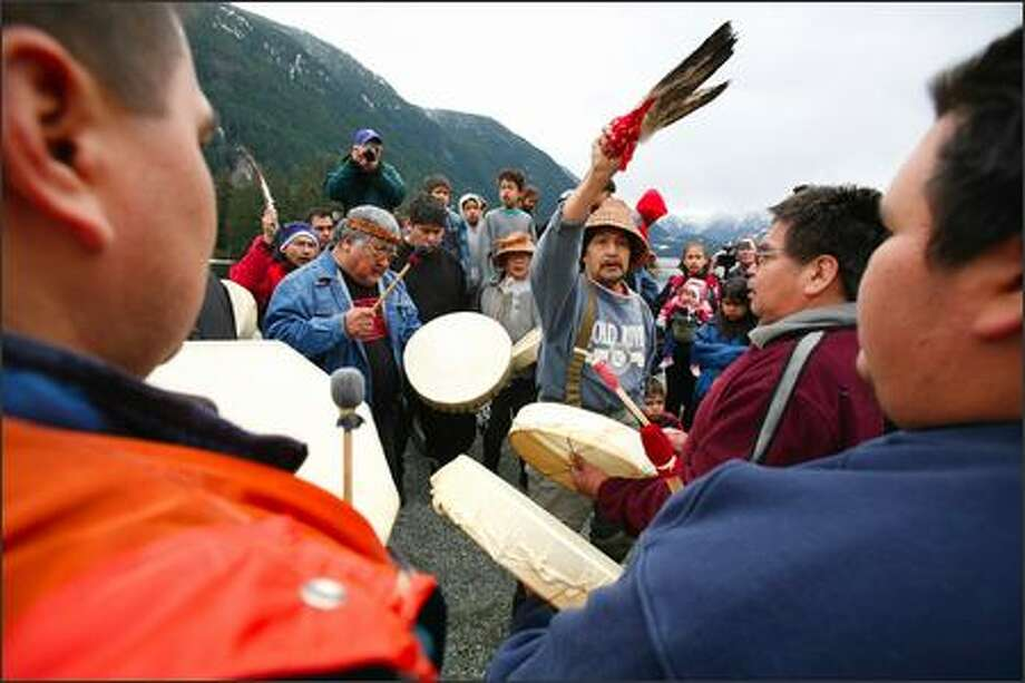 Sam Johnson, center, leads a group of drummers during a memorial ceremony in Gold River, B.C., for Luna the orca, who died Friday. Photo: / Associated Press