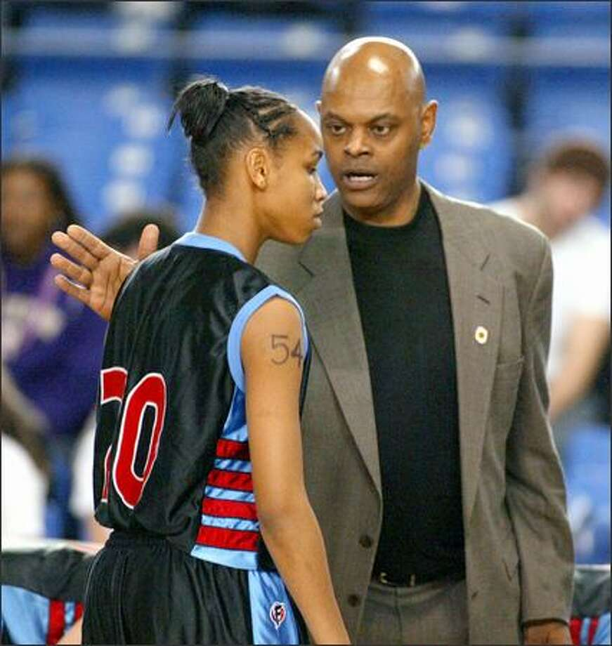 Chief Sealth head coach Ray Willis, with Charmaine Barlow, got his team into the 3A championship game despite allegations of illegal recruiting leading up to the tournament. Photo: / Associated Press