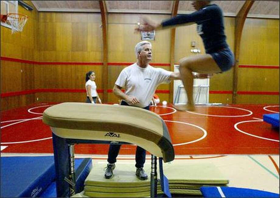 The High Point Neighborhood Center isn't a state-of-the-art gymnastics venue, but coach Ron Young didn't care. He saw a need and served it, coaching the West Seattle team. Photo: Meryl Schenker/Seattle Post-Intelligencer
