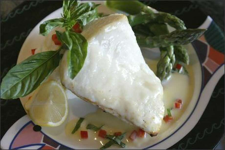 Anthony's HomePort restaurants are offering alder planked halibut with a smoked garlic beurre blanc. Photo: Gilbert W. Arias/Seattle Post-Intelligencer