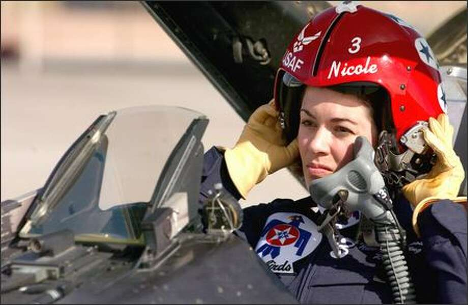"Capt. Nicole Malachowski, who was selected last summer for the Thunderbirds team, is scheduled to perform for the first time this month at Fort Smith, Ark. ""I'm an Air Force officer first, a pilot second and then Nicole,"" she says. Photo: U.S. AIR FORCE"