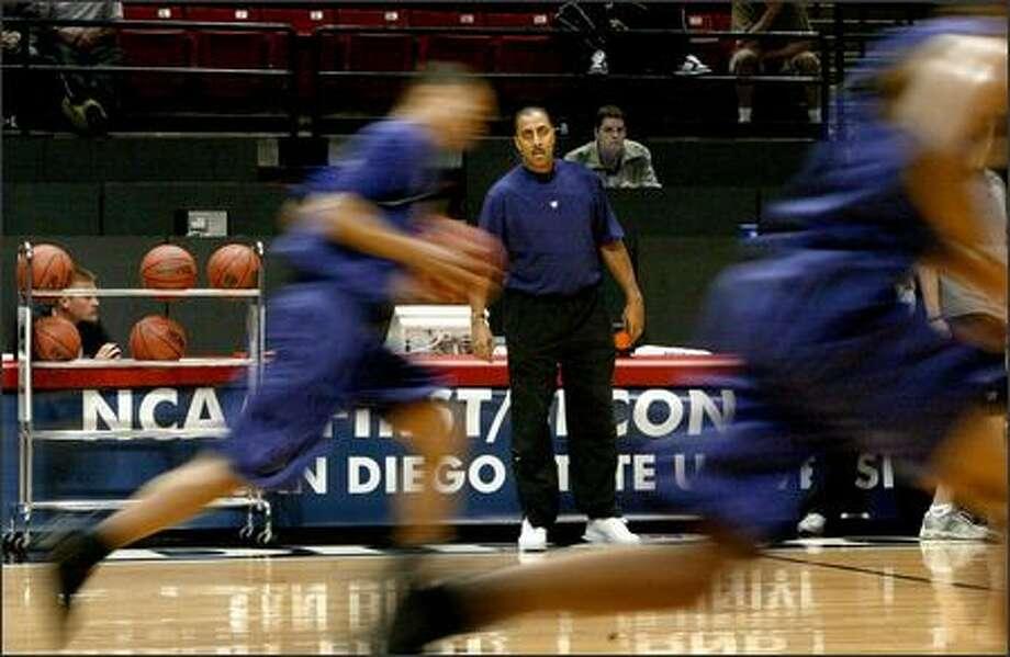 Washington coach Lorenzo Romar, whose team wants to rebound from a Pac-10 tournament loss to Oregon, watches drills at Cox Arena. Photo: Scott Eklund/Seattle Post-Intelligencer