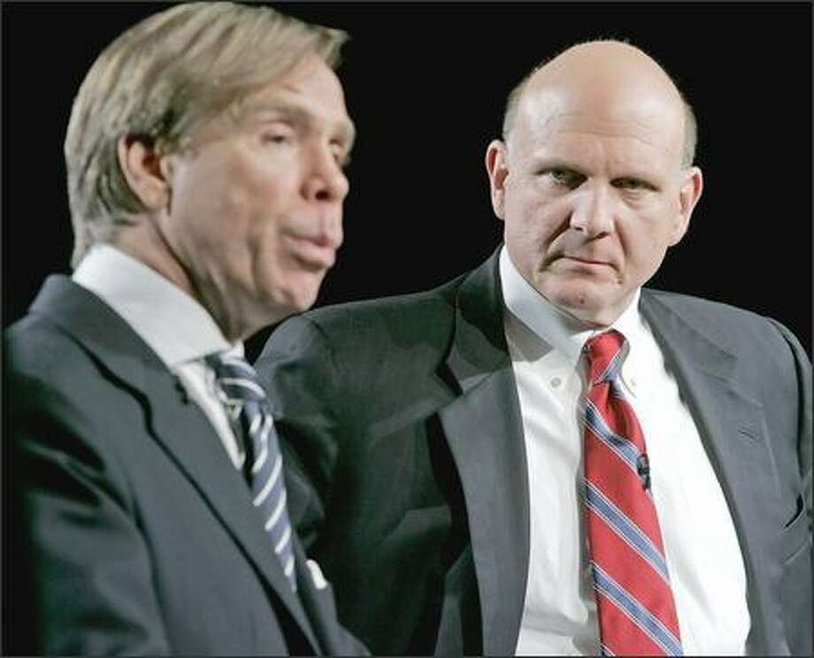 Microsoft CEO Steve Ballmer, right, listens as fashion designer Tommy Hilfiger speaks at the New York launch of Microsoft's new $500 million global marketing push aimed at boosting sales to businesses. Photo: / Associated Press