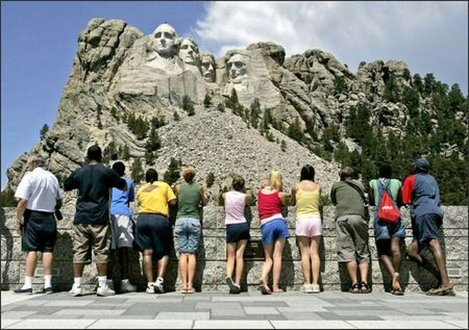 Some are so upset they say they will never visit Mount Rushmore, South Dakota's No. 1 tourist attraction. Others say they're so thrilled they'll make a point of coming to see the faces of four U.S. presidents in the Black Hills. Photo: / Associated Press