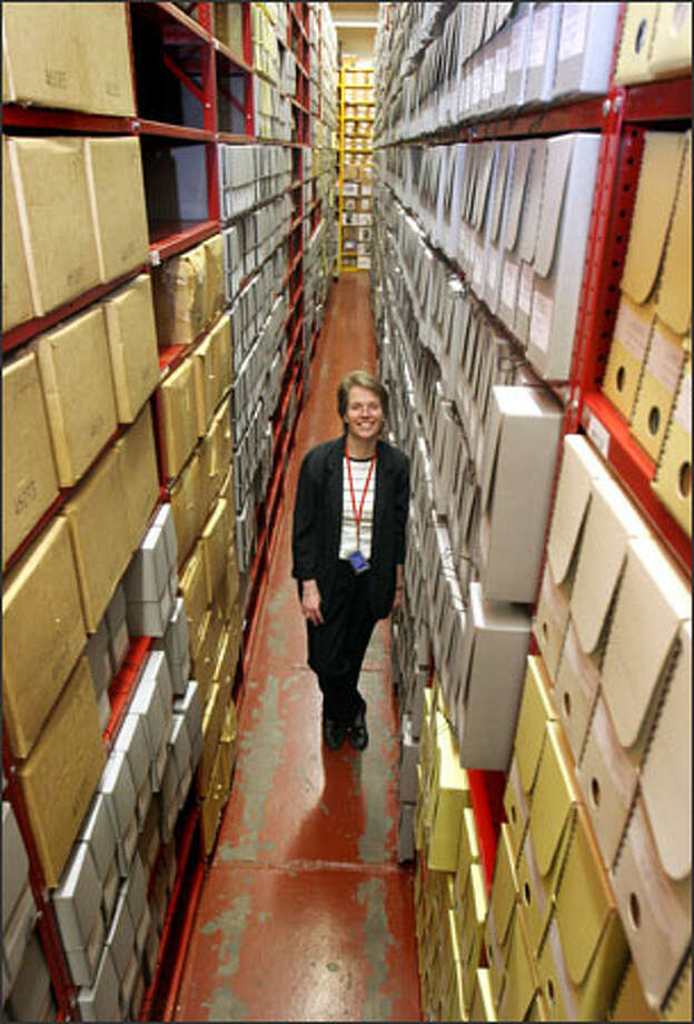 Susan Karren is a senior archivist at the National Archives and Records Administration office. The Sand Point building houses millions of records that reflect the federal government's Northwest ties. Photo: Meryl Schenker/Seattle Post-Intelligencer