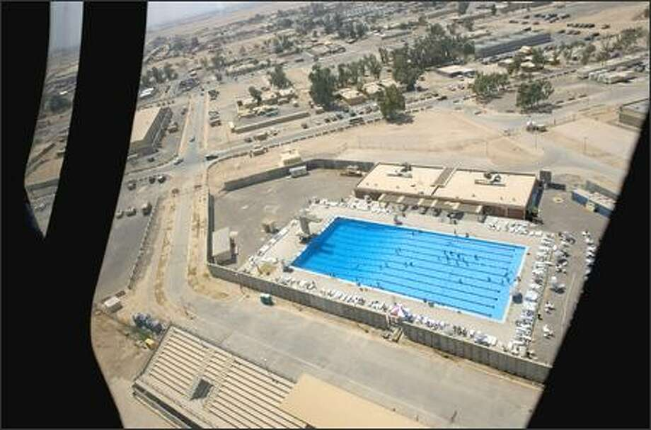 The Olympic-size swimming pool at Balad air base as seen through the window of a U.S. helicopter about 44 miles north of Baghdad. Photo: / Associated Press