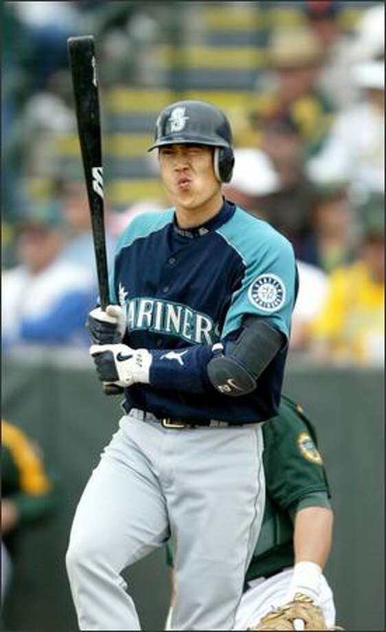 "Any concerns about Kenji Johjima not aggressively stepping into his role as M's catcher have dissipated. ""He has a presence,"" manager Mike Hargrove says. Photo: Scott Eklund/Seattle Post-Intelligencer"