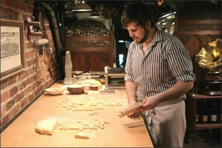Justin Neidermeyer makes handmade pasta in a loft that overlooks the dining room at Via Tribunali restaurant on Capitol Hill and sells it under the label Pian Pianino Pastificio Artigianale at the Sunday Ballard Farmers Market. The loft is warm and whispers Italian to all who enter. Photo: Meryl Schenker/Seattle Post-Intelligencer