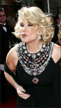 "Joan Rivers, who's never seen a plastic surgeon she didn't love, has discovered Match.com. She and an assistant created a profile for the 72-year-old fashion screecher who sends stars scurrying from the red carpet. She told The Associated Press, ""We were hoping to meet Mr. Right. We didn't even get a wink."" Photo: / Associated Press"
