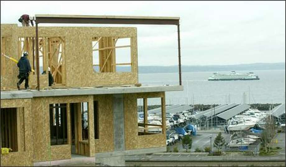 The Point Edwards condominium development -- more than 300 units in 10 low-rise buildings -- is going up on a ridge south of Edmonds. Photo: Paul Joseph Brown/Seattle Post-Intelligencer