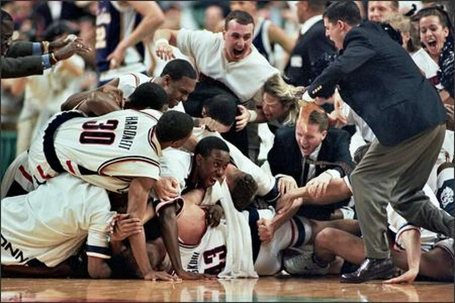 Connecticut players celebrate their last-second victory over Washington in the 1998 East Regional semifinal in Greensboro, N.C. Photo: Robin Layton/Seattle Post-Intelligencer