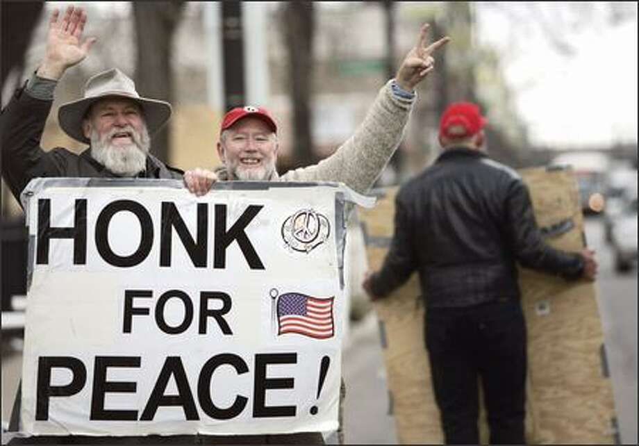 The Rev. Daniel Dale, left, and Dave Martin wave joyfully Thursday at a Christian Peacemaker Teams news conference in Chicago. Photo: / Associated Press