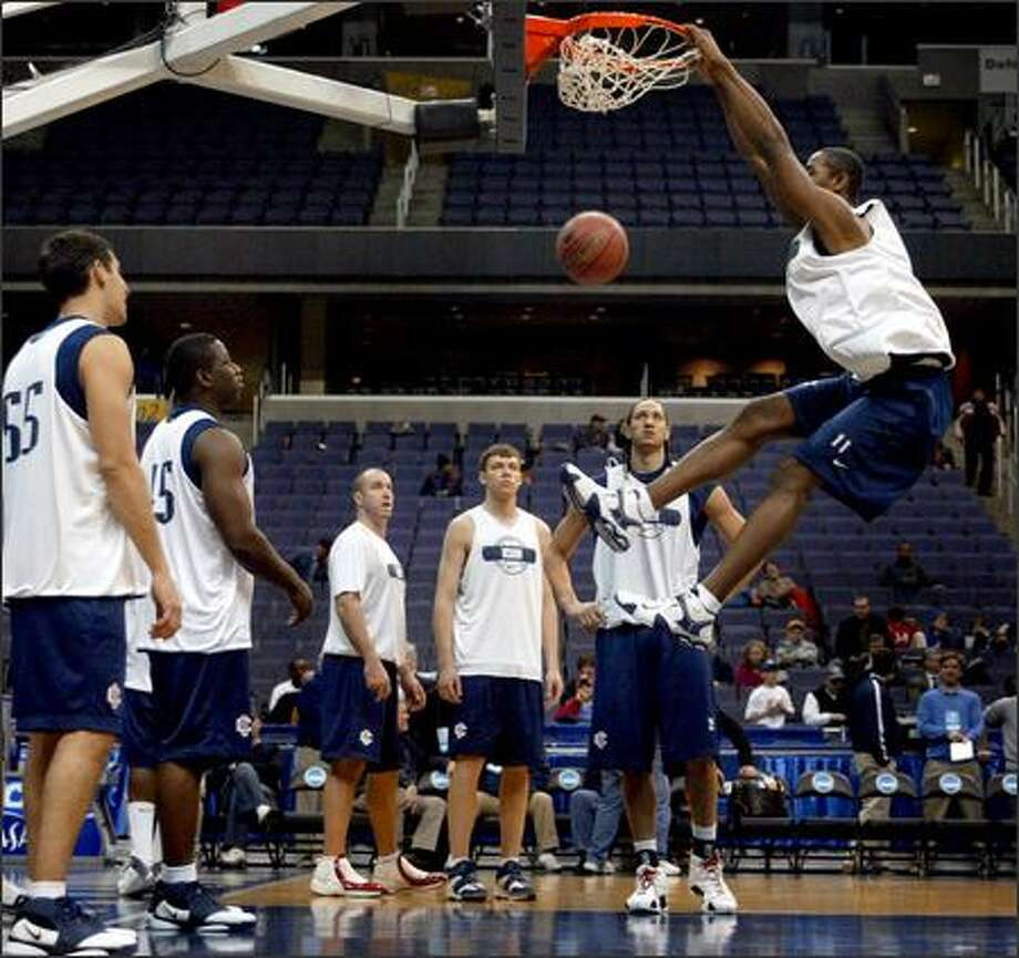 Connecticut's Hilton Armstrong dunks during practice Thursday. The Eastern Huskies average two inches taller than their UW opponents. Photo: Joshua Trujillo/Seattle Post-Intelligencer