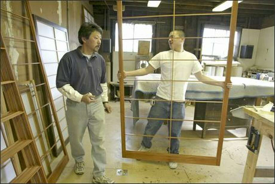 Mike Fujii and son Matt work at Bush Woodcraft in Seattle, one of the few West Coast shops that make Japanese shoji screens. Photo: Jim Bryant/Seattle Post-Intelligencer