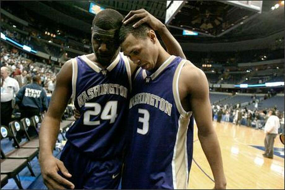 UW seniors Jamaal Williams, left, and Brandon Roy console each other after the abrupt end of their college careers Friday night. Williams scored a career-high 27 points. View a gallery of game photos Photo: Joshua Trujillo/Seattle Post-Intelligencer