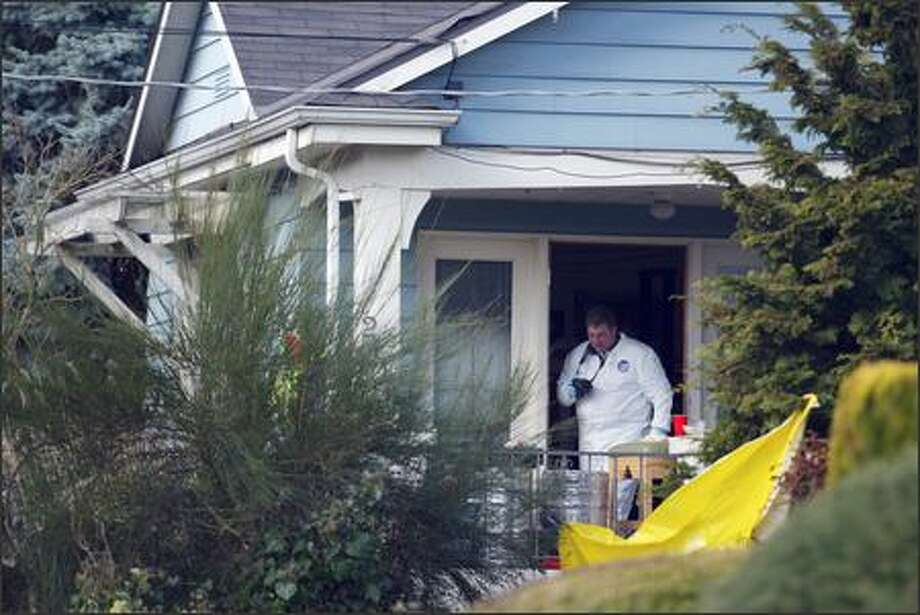 Police investigate the site of the shooting at 22nd Ave. E. and Republican St. on Capitol Hill. Photo: KAREN DUCEY/P-I