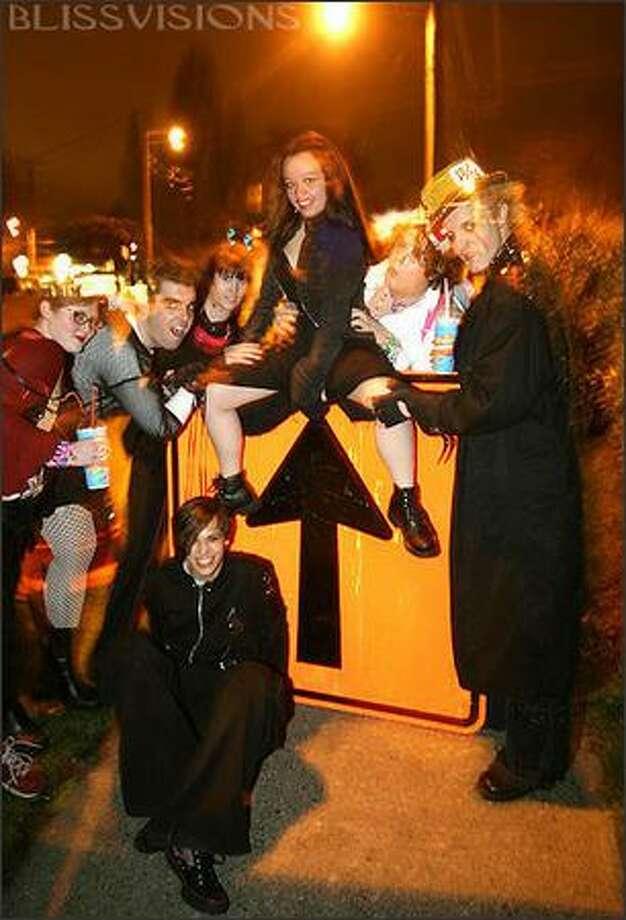 Local raver Onixx, center, with her friends Trixxi, Panda, Trinkit, Twiggy, White Rabbit and Loki. Photo: Jer Youngquist/candyrave.com