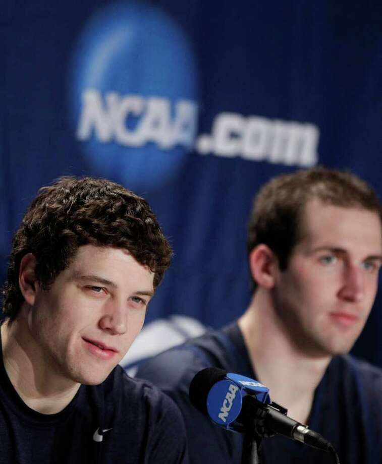 BYU's Jimmer Fredette, left, answers questions as Noah Hartsock listens during a news conference for the Southeast Regional third-round NCAA tournament college basketball game, Friday, March 18, 2011, in Denver. BYU will play Gonzaga on Saturday. (AP Photo/Julie Jacobson) Photo: Julie Jacobson
