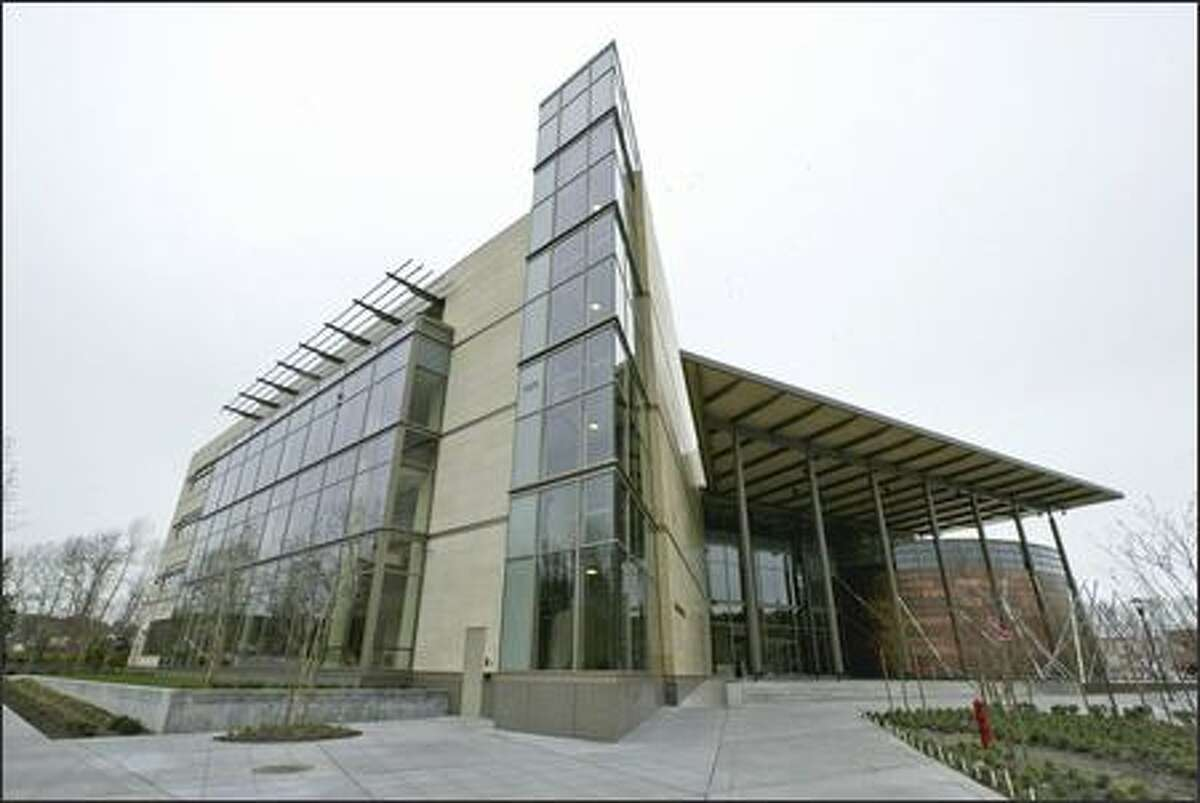 The new Redmond City Hall features a lot of glass, a 40-foot-high canopy roof and two-story lobby and a drum-shaped council chamber.