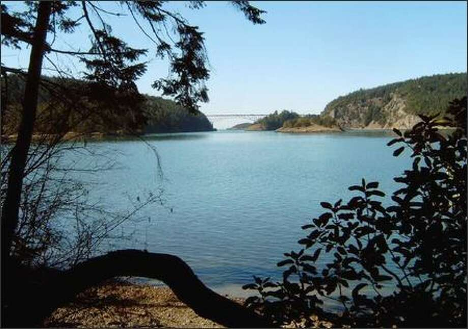 Look across Cornet Bay to the Deception Pass Bridge from one of several rarely used trails on Hoypus Hill. A new Green Trails map of Deception Pass State Park unveils these hidden gems. Photo: KAREN SYKES