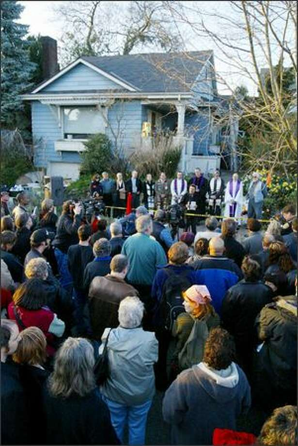 Hundreds attend the Service of Hope at 2112 E. Republican St. Tuesday for the seven who died in Saturday's shootings. The Church Council of Greater Seattle organized the interfaith service. Photo: Meryl Schenker/Seattle Post-Intelligencer
