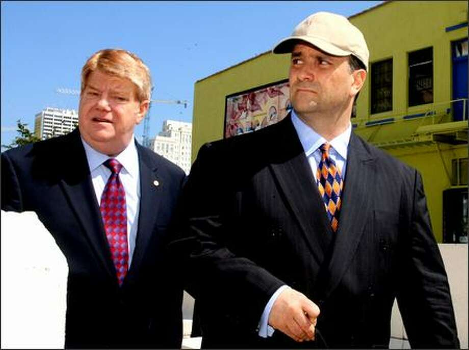 Former lobbyist Jack Abramoff, right, and attorney Neal Sonnett, left, leave the federal courthouse in Miami after sentencing in the SunCruz fraud case Wednesday. Photo: / Associated Press