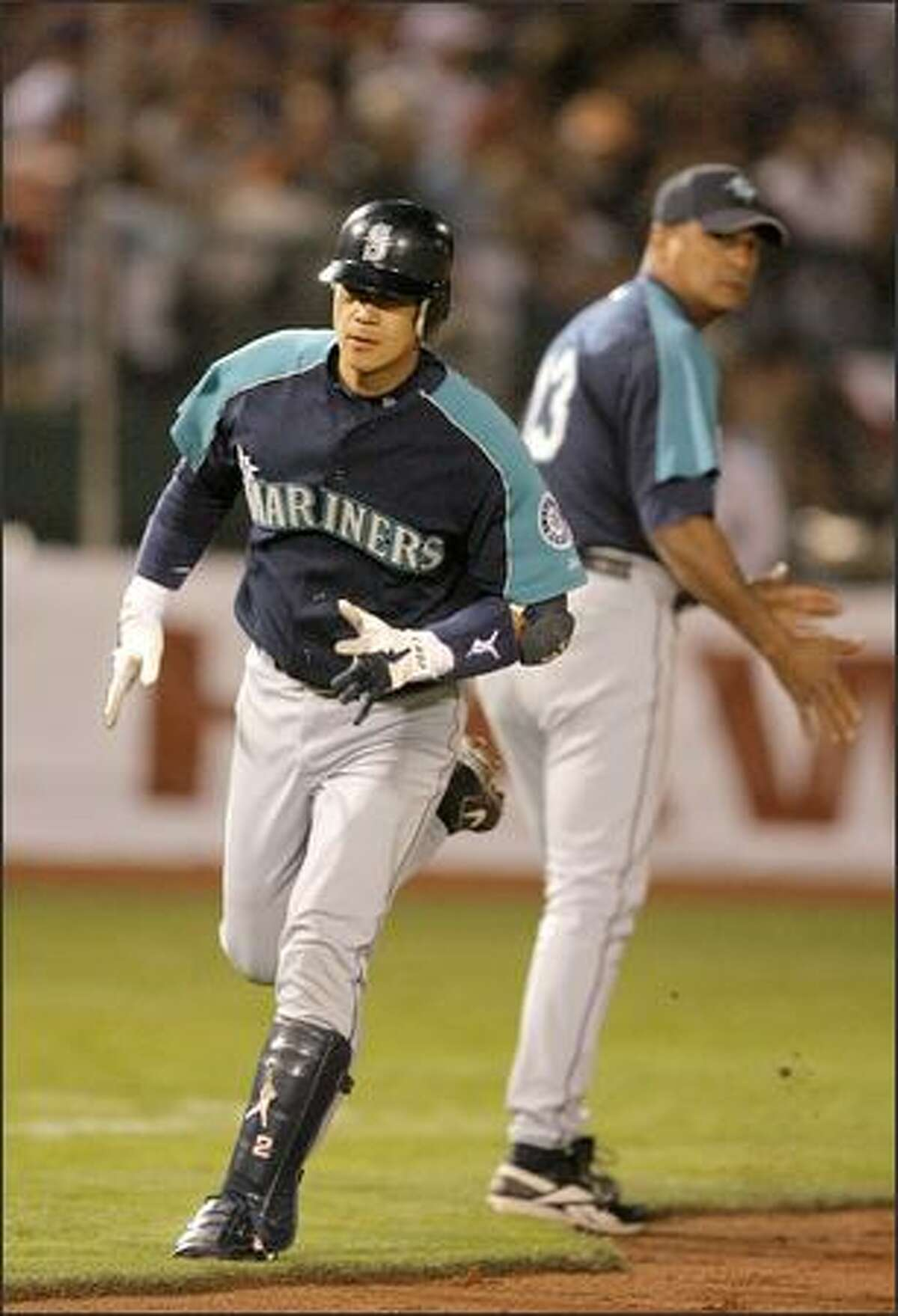 Mariners carcher Kenji Johjima rounds the bases on a solo home run against the Dodgers in Las Vegas.