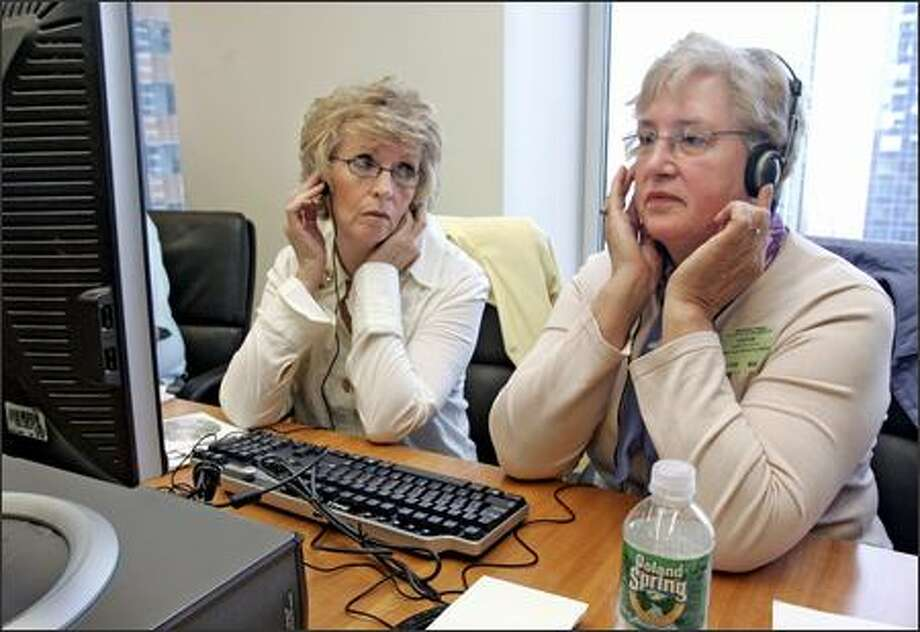 Rosemary Cain, left, and Barbara Hetzel listen to emergency calls from Sept. 11, 2001, that were released on Friday. Both lost firefighter sons in the attacks. Photo: / Associated Press