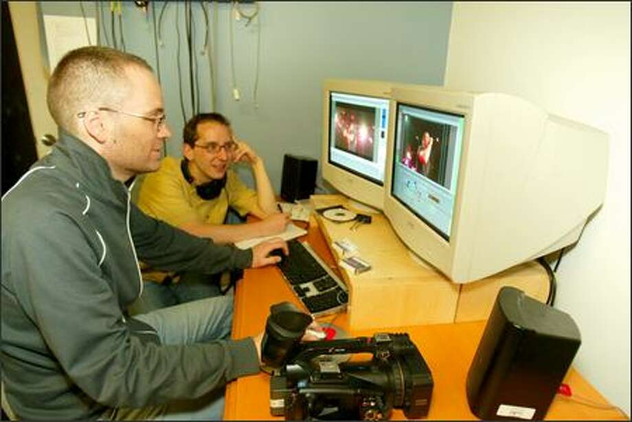 Amateur filmmakers Erik Koto, 31, left, and Robert Nachbar, 36, edit their documentary about Creation Fest 2005, a four-day concert at The Gorge. The result was a 30-minute movie about the experience. Photo: Grant M. Haller/Seattle Post-Intelligencer