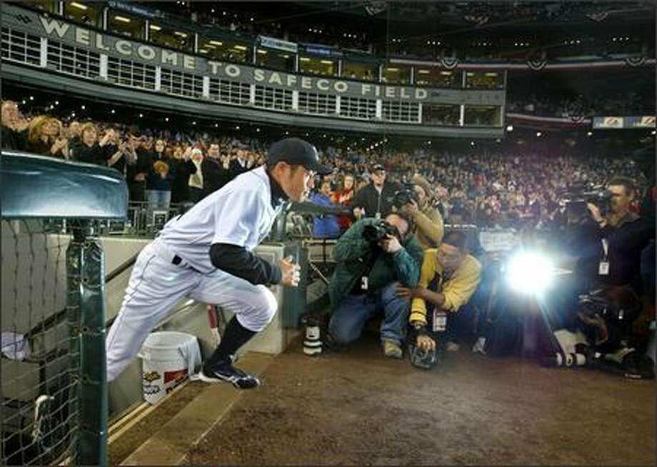 Seattle Mariners right fielder and leadoff hitter Ichiro Suzuki runs onto Safeco Field before Monday's season opener, which the Los Angeles Angels won 5-4. Photo: Scott Eklund/P-I