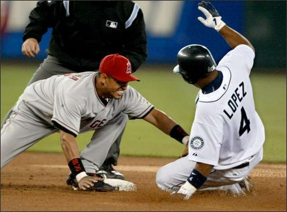 M's second baseman Jose Lopez got two hits Monday but was tagged out in the fifth inning by Orlando Cabrera after singling and trying to take second base. Photo: Scott Eklund/Seattle Post-Intelligencer
