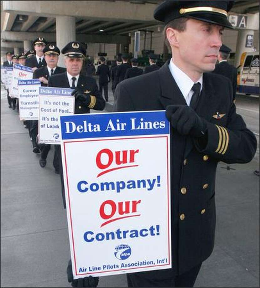 Delta Air Lines pilots, shown here in a recent information picket in Hebron, Ky., voted 94.7 percent in favor of authorizing a strike. Photo: / Associated Press