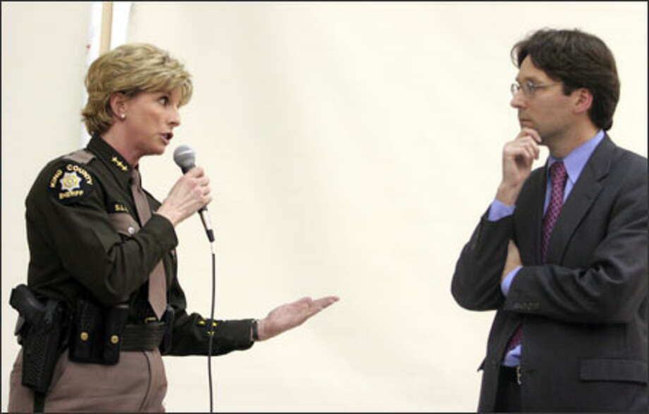 King County Sheriff Sue Rahr and King County Councilman Bob Ferguson square off at Tuesday night's meeting. Photo: Meryl Schenker/Seattle Post-Intelligencer