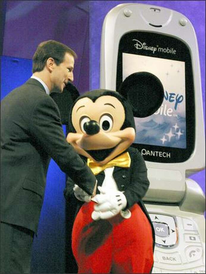 Steve Wadsworth, president and chief executive officer of the Walt Disney Internet Group, announces a new mobile-phone service with Mickey Mouse at the Cellular Telecommunications & Internet Association Conference in Las Vegas on Wednesday. Photo: / Bloomberg News