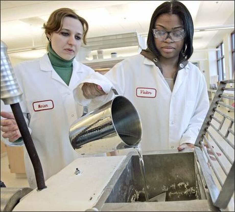Lab technicians Marian Ingersoll, left, and Nakia Taylor add flavoring to chewing gum at Wm. Wrigley Jr. Co.'s product-testing center in Chicago. The 115-year-old company has created the Wrigley Science Institute to look for scientific proof that chewing gum has health benefits. Photo: / Associated Press