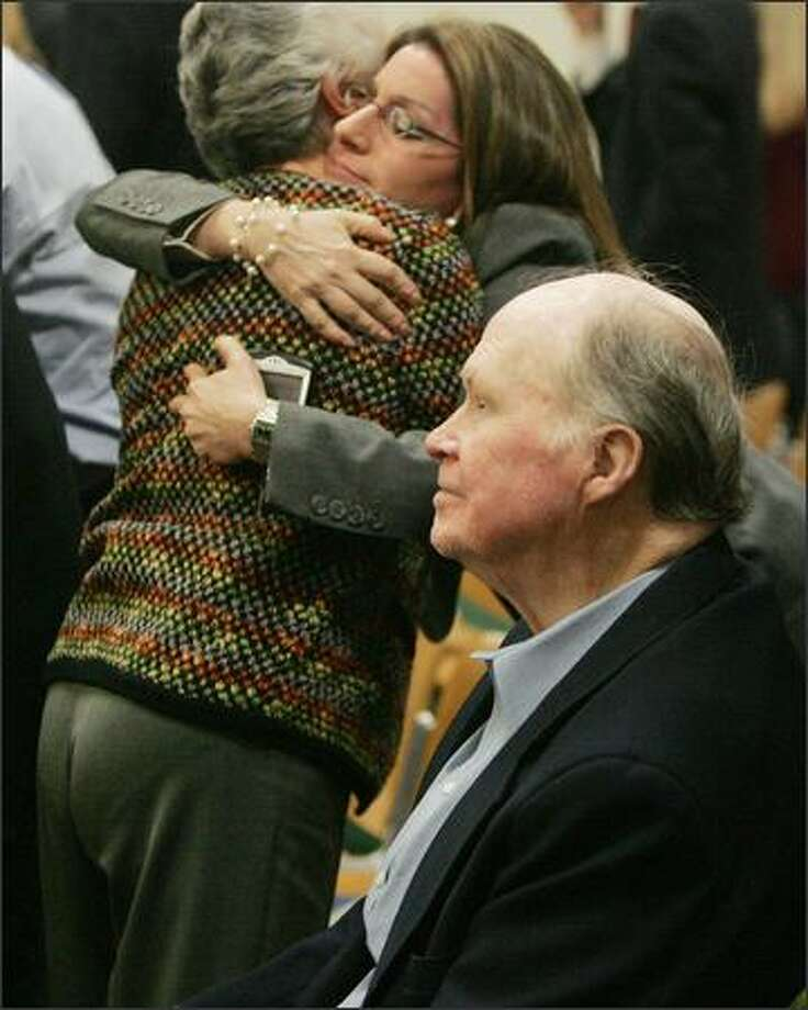 John McDarby, right, 77, of Park Ridge, N.J., won his case against Merck Wednesday. McDarby was awarded $3 million and his wife, Irma, left, hugging attorney Sheri Tarr, right rear, was awarded $1.5 million. Photo: / Associated Press
