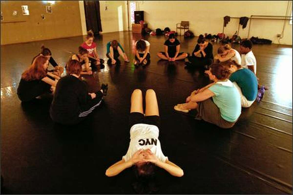 Sara Sabandal, center, of Woodinville prays at the conclusion of a class at the Westlake Dance Center. Students may pray in silence or aloud as they sit in the circle.