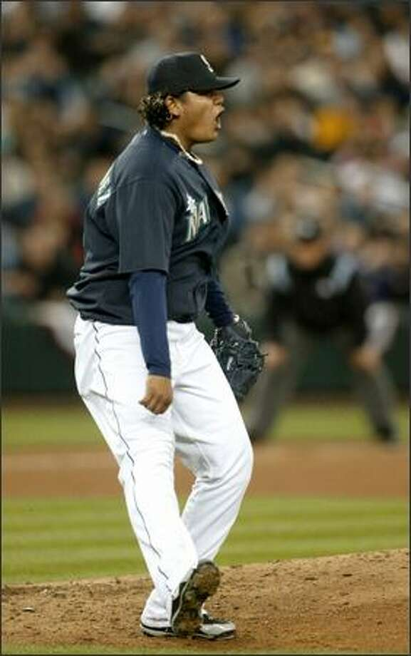 Felix Hernandez does a little dance after striking out Oakland's Eric Chavez to end the fifth inning. View a gallery of game photos. Photo: Meryl Schenker/Seattle Post-Intelligencer
