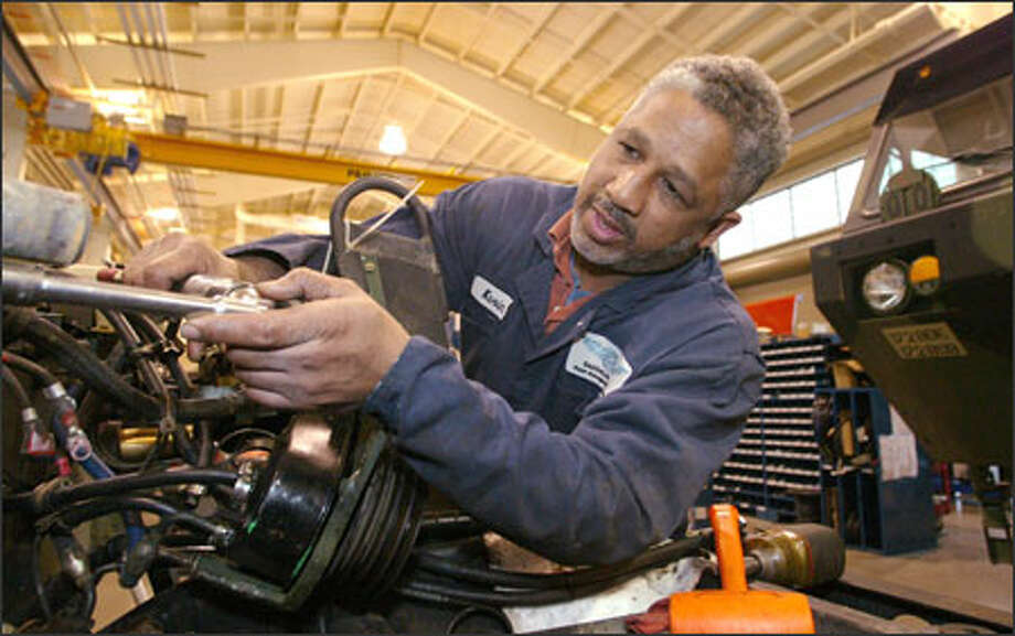 Army veteran Kevin Ramsey, 47, works for Skookum Enterprises, which hires the disabled to repair combat vehicles at Fort Lewis. Photo: Gilbert W. Arias/Seattle Post-Intelligencer / Seattle P-I