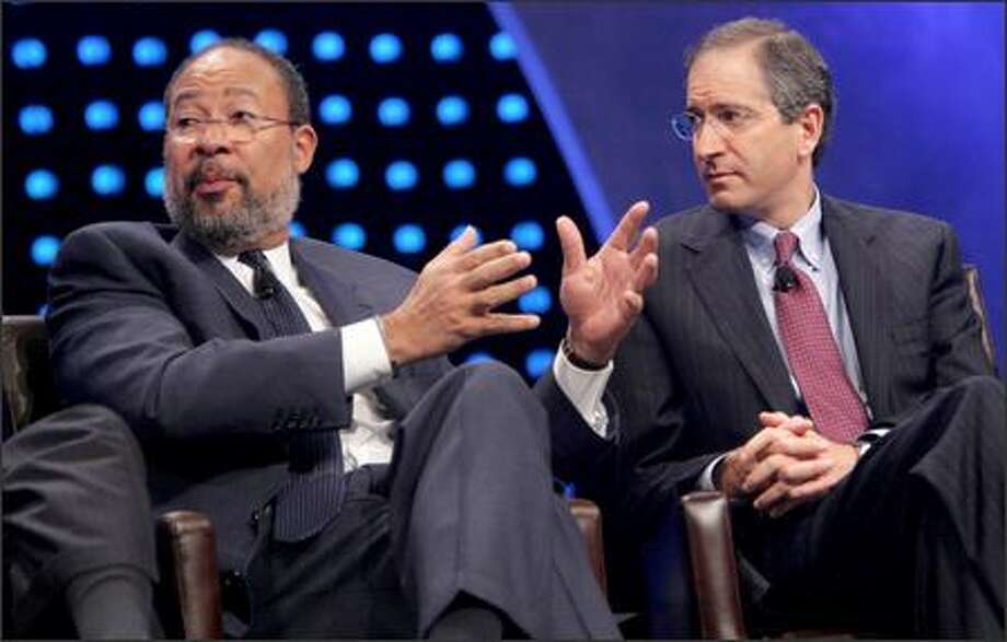 Richard Parsons, left, chairman and CEO of Time Warner, and Comcast Chairman and CEO Brian Roberts participate in a discussion Monday at the National Cable Television Association's conference. Photo: / Associated Press