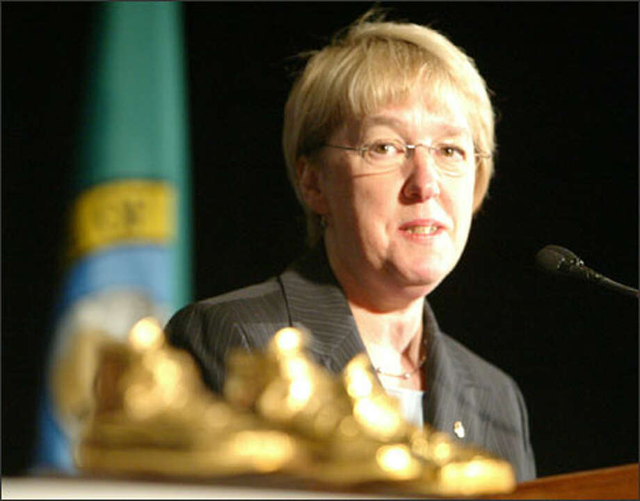 Sen. Patty Murray, D-Wash., handed out the 11th annual Golden Tennis Shoe Awards on Monday to exceptional volunteers in the community. Photo: Gilbert W. Arias/Seattle Post-Intelligencer / Seattle P-I