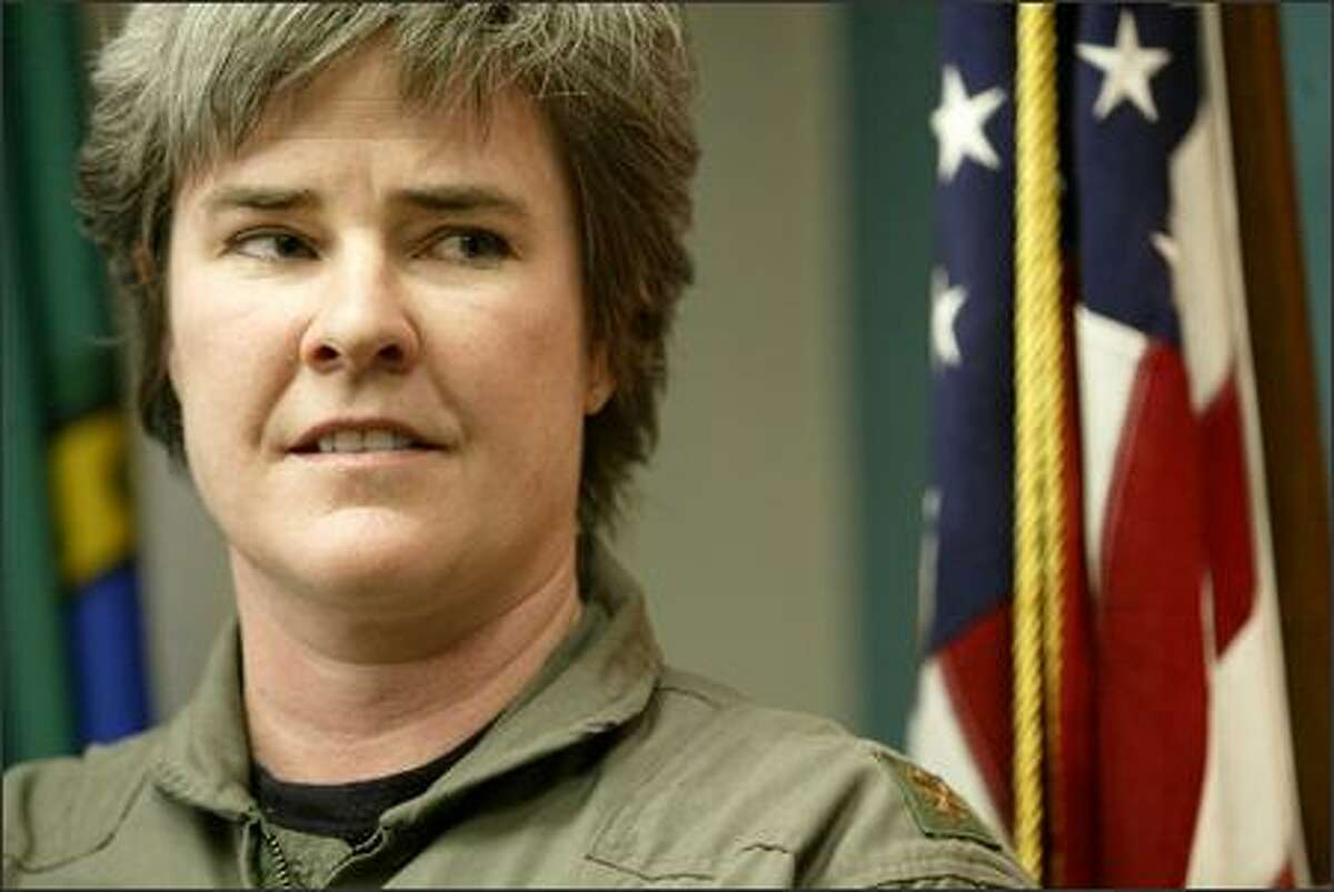 """Maj. Margaret Witt told a news conference Wednesday, """"My objective is to go back to my unit and serve my country."""""""