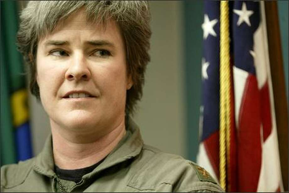 """Maj. Margaret Witt told a news conference Wednesday, """"My objective is to go back to my unit and serve my country."""" Photo: Dan DeLong/Seattle Post-Intelligencer"""